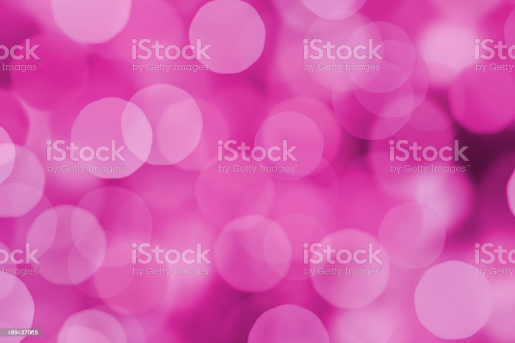 Blurred purple and pink bokeh dots stock photo