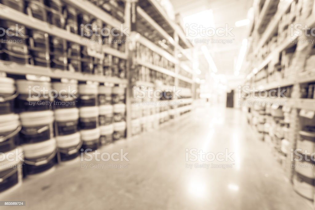 Blurred verity of wall, floor, interior, exterior paint/stain cans...