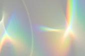 istock Blurred rainbow light refraction texture on white wall 1253848832