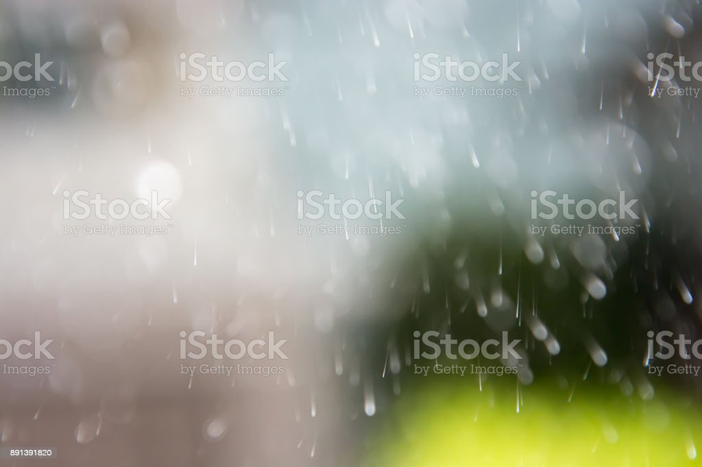 blurred raindrops in summer storm stock photo