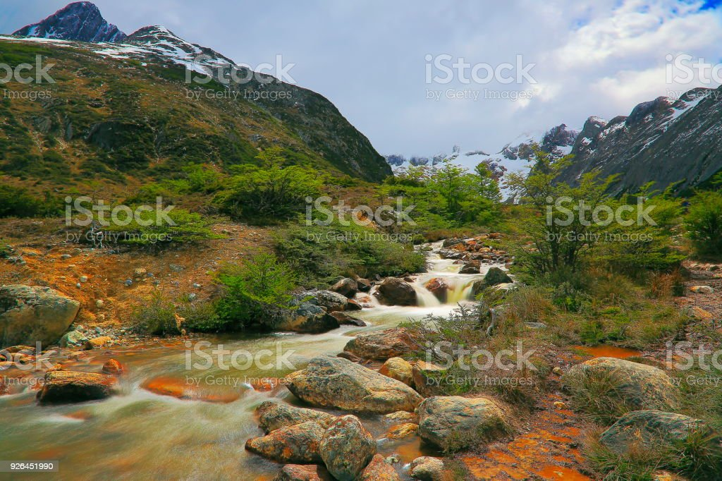 Blurred River from long exposure and Idyllic Ushuaia - Tierra Del fuego, Argentina stock photo