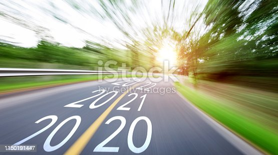 1150191246 istock photo Blurred road with Number 2020, 2021, 2022 1150191447
