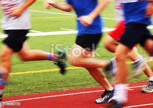 istock blurred runners on a track 976685710
