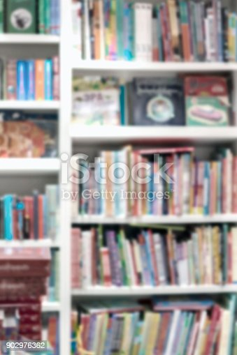istock Blurred school library bookshelfs with colorful books, manuals and textbooks. Education, school, study concept. For abstract background 902976362