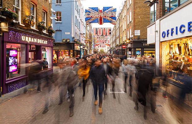 Blurred 'sea' of Christmas Shoppers on Carnaby Street, London. London, England - December 17, 2016: A blurred 'sea' of Christmas Shoppers on Carnaby Street, London. In London, England. On 17th December 2016. carnaby street stock pictures, royalty-free photos & images
