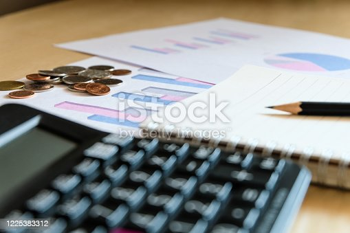 670717016 istock photo Blurred selective focus, Cost reduction calculating on financial, tax and business infographic graph pie chart. Tax and expense cost saving for personal. Economic crisis during Covid-19 pandemic 1225383312