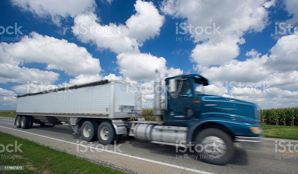 Blurred semi-truck under crazy clouds royalty-free stock photo