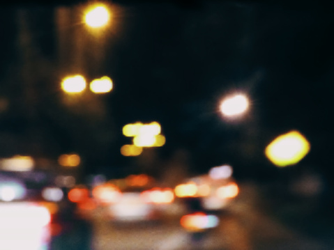 Blurred shape of the cars and the lights