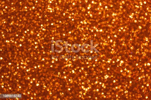929640504 istock photo Blurred shiny golden background with sparkling lights. 1084816240