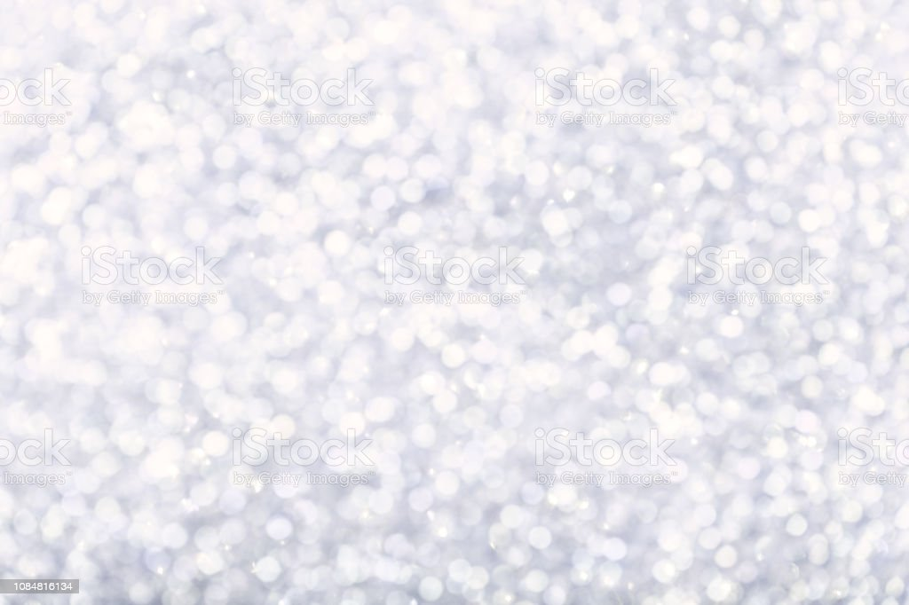 Blurred white background with circle sparkling lights. Shiny pastel...