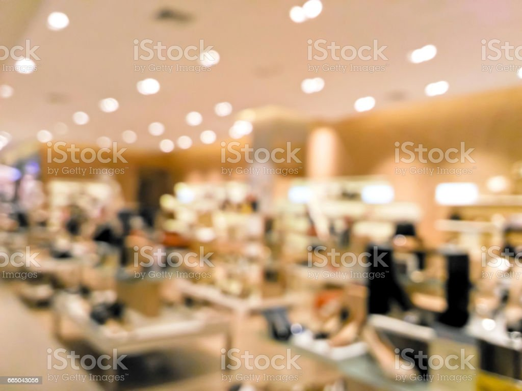Blurred shoes on display shelves stock photo
