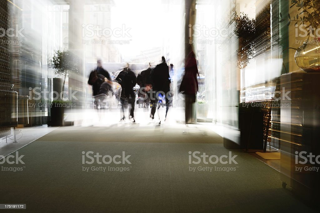 Blurred shoppers exits royalty-free stock photo