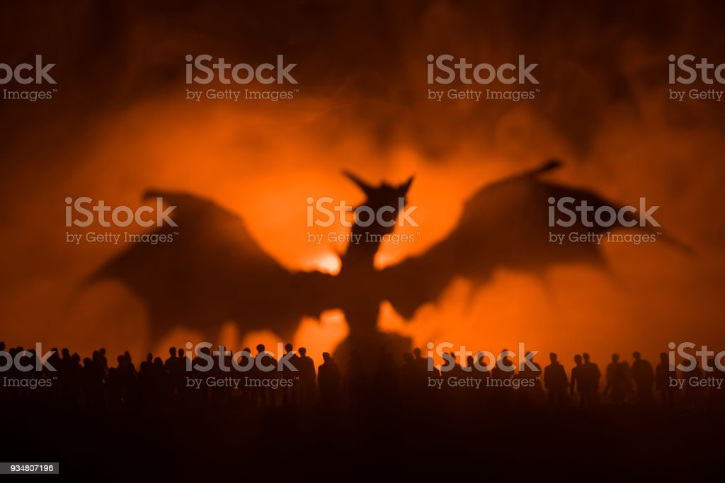 Blurred silhouette of giant monster prepare attack crowd during night. Selective focus. Decoration