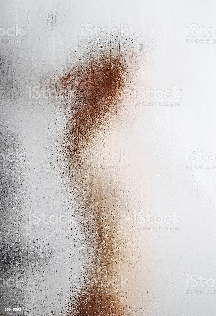 Blurred silhouette through weeping glass royalty-free stock photo