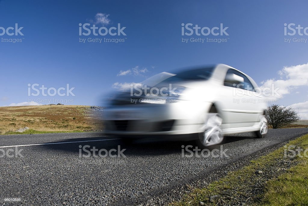 Blurred silver car on mountain road stock photo