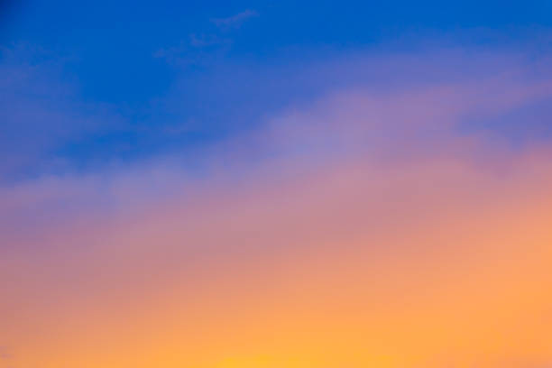blurred sky during sunset - gradient background - atmospheric mood stock photos and pictures