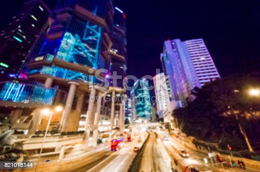 860696690 istock photo Blurred Skyline with buildings and cars at night in Hong Kong city 821018144