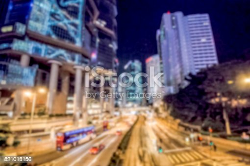 860696690 istock photo Blurred Skyline with buildings and cars at night in Hong Kong city 821018156