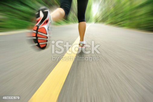 494003079istockphoto blurred sports woman legs running at  trail 492332879