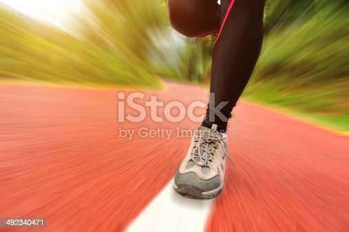 494003079istockphoto blurred sports woman legs running at  trail 492340471