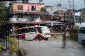 Nepal road rain view to street through rain-specked window