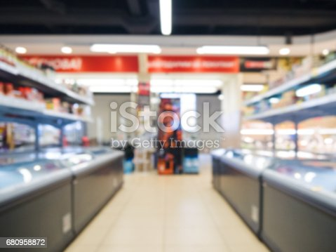 968898244 istock photo blurred supermarket aisle 680958872