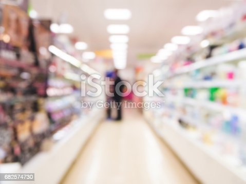 968898244 istock photo blurred supermarket aisle 682574730