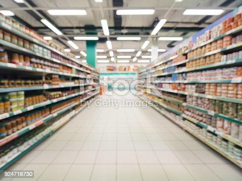 968898244 istock photo blurred supermarket aisle 924716730