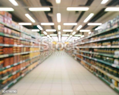 968898244 istock photo blurred supermarket aisle 924716790