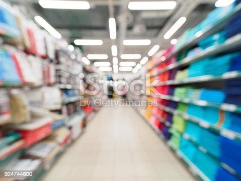 968898244 istock photo blurred supermarket aisle 924744600