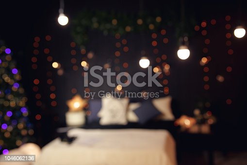 istock Blurred texture of the room with Christmas lights 1046062136