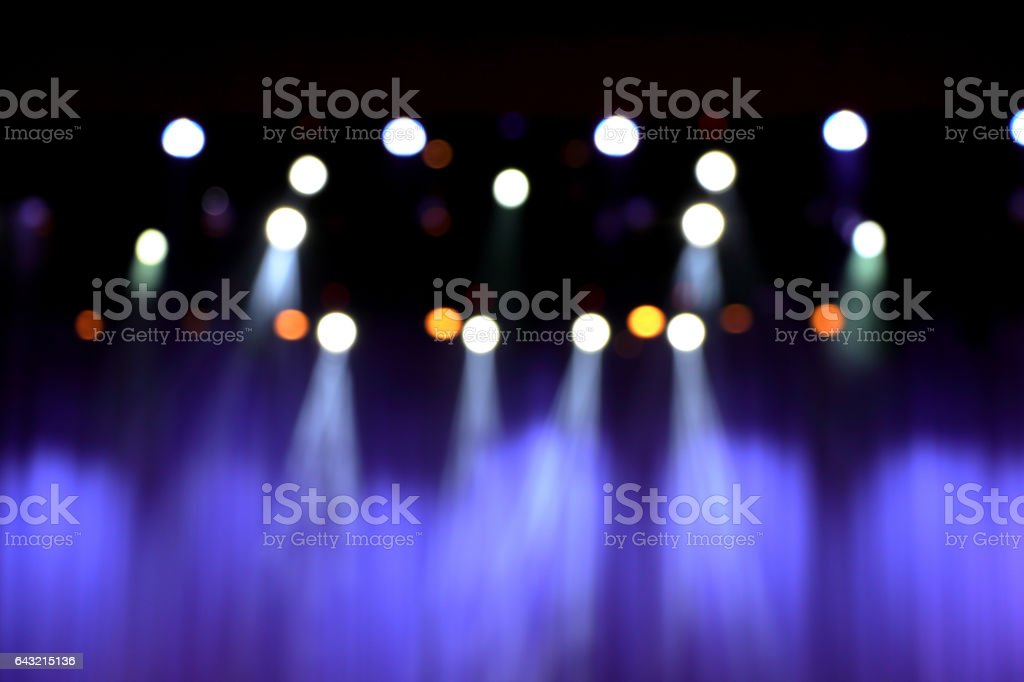 blurred theater stage with purple curtains and spotlights. stock photo