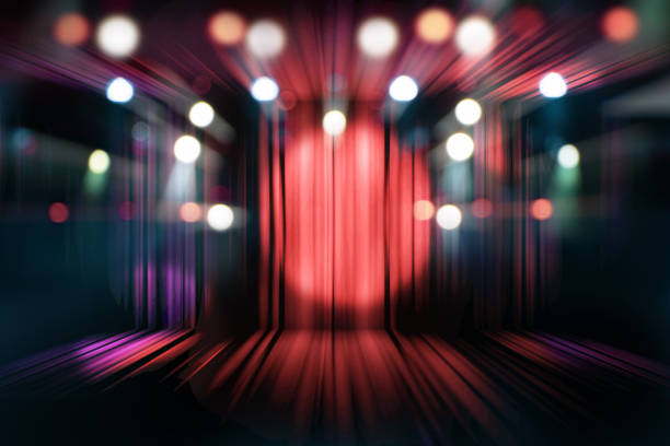 blurred theater stage with red curtains and spotlights, abstract image of concert lighting - awards ceremony stock pictures, royalty-free photos & images