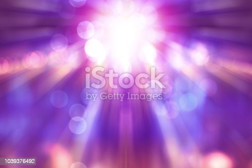 blurred theatre show with purple light on stage, abstract image of concert lighting