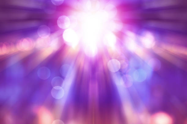 blurred theatre show with purple light on stage, abstract image of concert lighting - d'atmosfera foto e immagini stock
