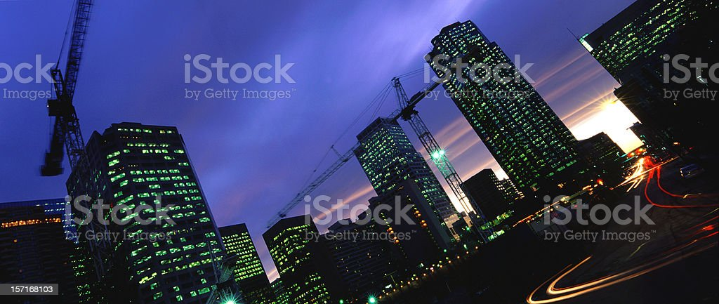Blurred Tower Cranes and Traffic royalty-free stock photo