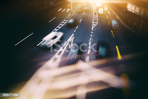 599471112 istock photo blurred traffic  in central district 599471090