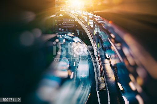 istock blurred traffic  in central district 599471112