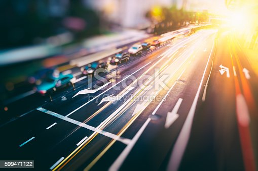 599471112istockphoto blurred traffic  in central district 599471122