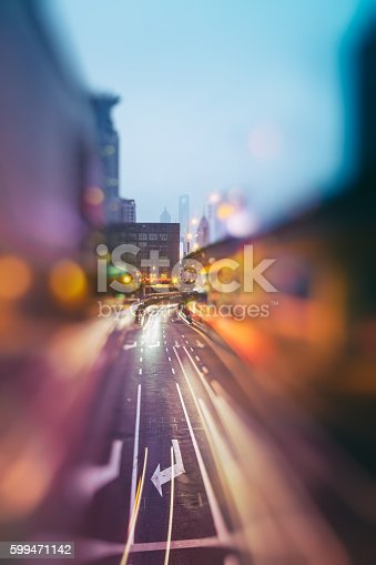 599471112 istock photo blurred traffic  in central district 599471142