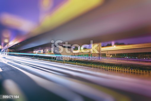 599471112 istock photo blurred traffic  in central district 599471164