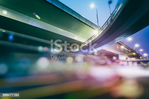 599471112 istock photo blurred traffic  in central district 599471184