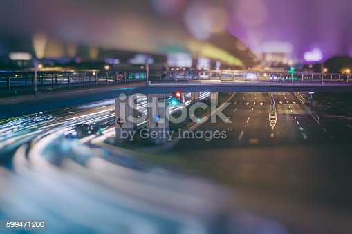 599471112 istock photo blurred traffic  in central district 599471200