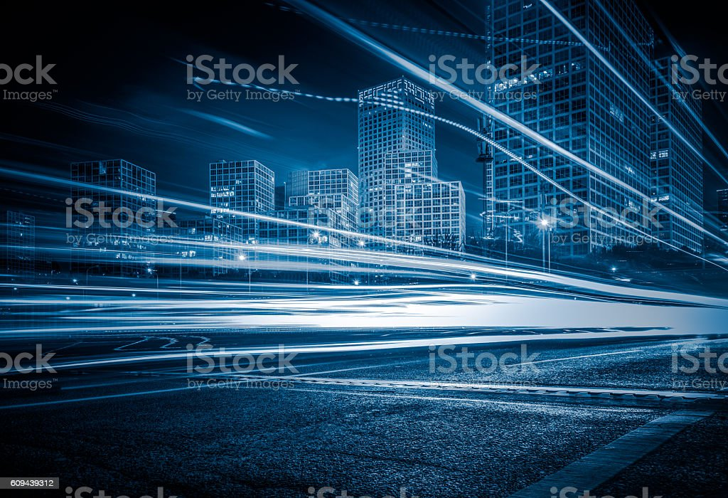 blurred traffic light trails on road stock photo
