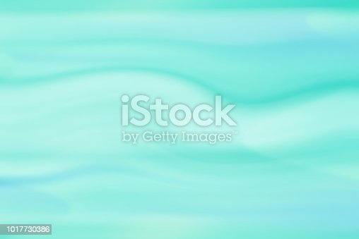 istock Blurred turquoise wave background 1017730386