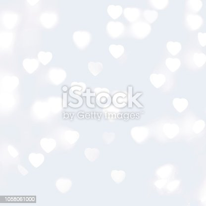 istock Blurred Unfocussed White Lights in the Shape of Heart White Background 1058061000