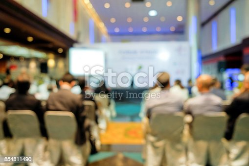 istock Blurred view from behind the audience on seminar 854811490