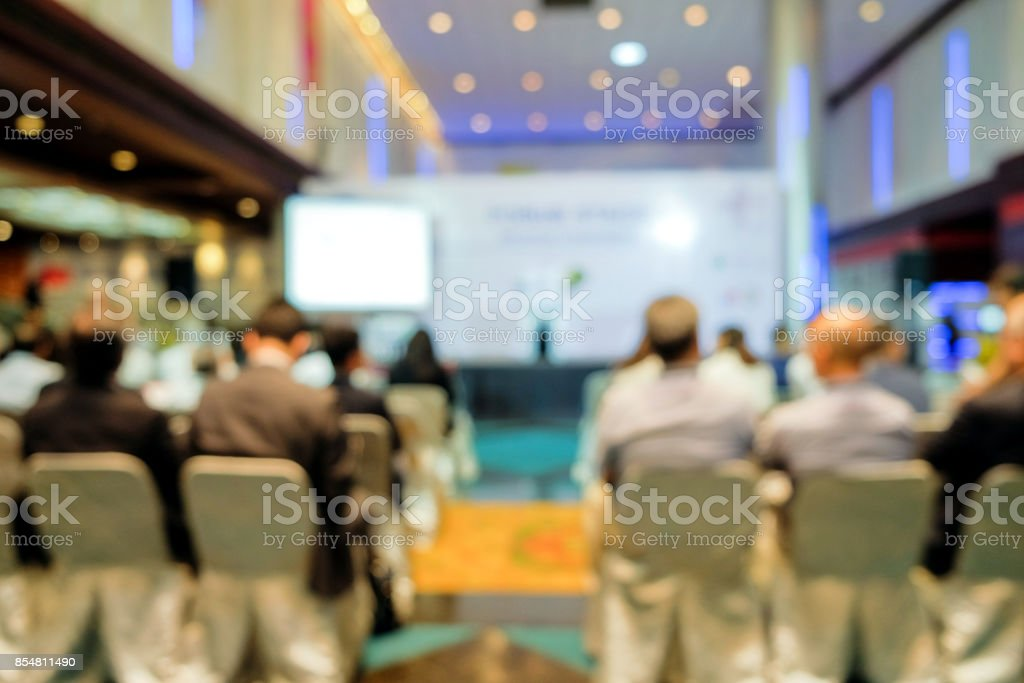 Blurred view from behind the audience on seminar stock photo