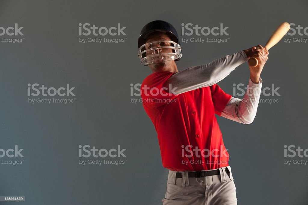 Blurred view of baseball player swinging bat  royalty-free stock photo