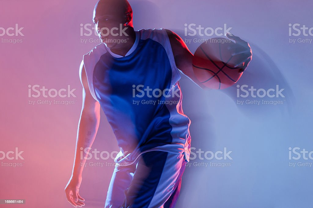 Blurred view of basketball player dribbling stock photo